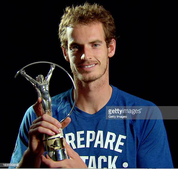 Tennis player Andy Murray of Great Britain poses with the award for Laureus World Breakthrough of the Year which was announced during the 2013...
