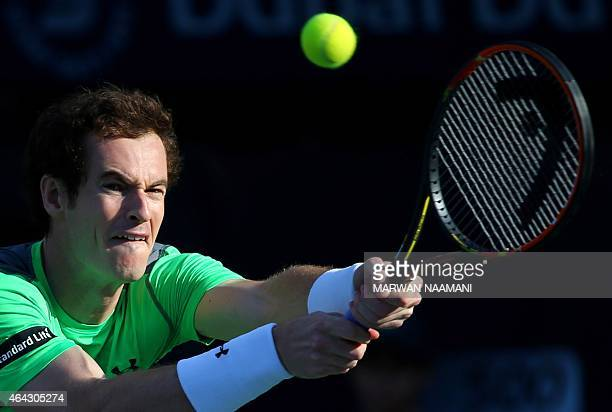 Tennis player Andy Murray of Great Britain returns the ball to Gilles Muller of Luxembourg during their match in the second day of the ATP Dubai Duty...