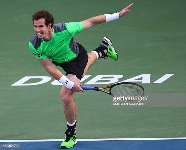 Tennis player Andy Murray of Great Britain serves the ball to Gilles Muller of Luxembourg during their match in the second day of the ATP Dubai Duty...