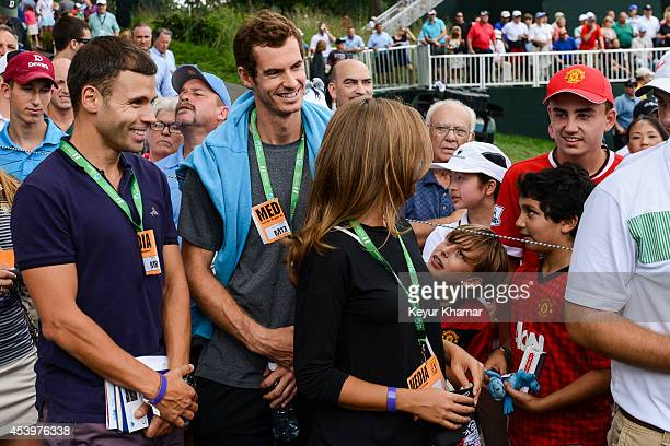 Tennis player Andy Murray of Great Britain smiles while greeting young fans at the fifth hole during the second round of The Barclays at Ridgewood...