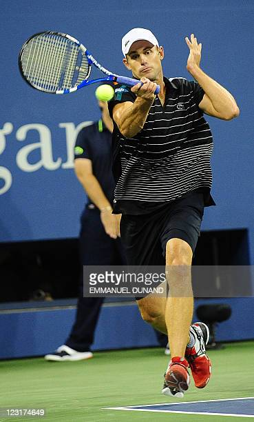 Tennis player Andy Roddick returns a point against US Michael Russell during their Men's US Open 2011 match at the USTA Billie Jean King National...