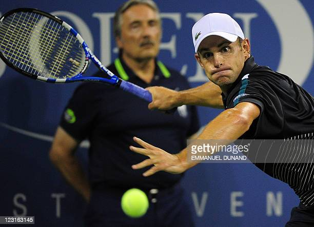 Tennis player Andy Roddick returns a shot to US Michael Russell during their Men's US Open 2011 match at the USTA Billie Jean King National Tennis...