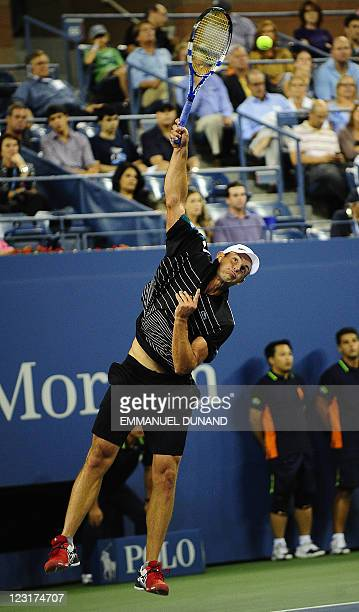Tennis player Andy Roddick serves a point against US Michael Russell during their Men's US Open 2011 match at the USTA Billie Jean King National...