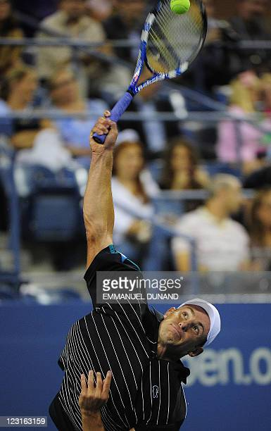 Tennis player Andy Roddick serves to US Michael Russell during their Men's US Open 2011 match at the USTA Billie Jean King National Tennis Center in...