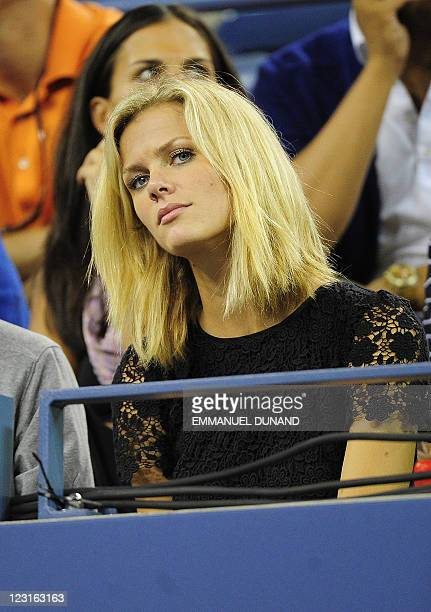 Tennis player Andy Roddick's wife Brooklyn Decker watches her husband play against US Michael Russell during their Men's US Open 2011 match at the...