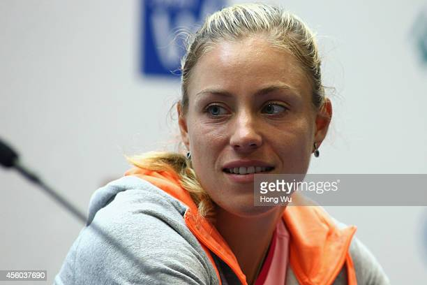 Tennis player Angelique Kerber of Germany attends a press conference on day four of 2014 Dongfeng Motor Wuhan Open at Optics Valley International...