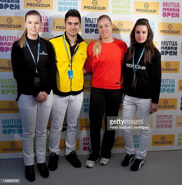 Tennis player Angelique Kerber of Germany poses for a photograph at the Prosegur stand during the second day of the WTA Mutua Madrilena Madrid Open...