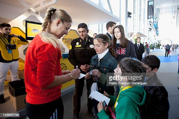 Tennis player Angelique Kerber of Germany signs autographs at the Prosegur stand during the second day of the WTA Mutua Madrilena Madrid Open Tennis...