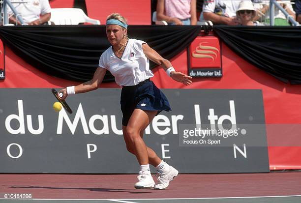 Tennis player Anke Huber of Germany serves during the women 1995 DU Maurier Open Tennis Tournament at the Uniprix Stadium in Montreal Quebec Canada