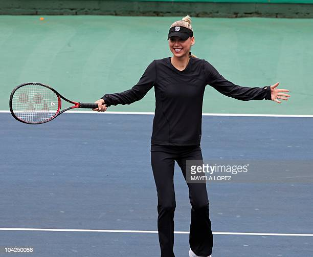 Tennis player Anna Kournikova reacts September 18 at a hotel in Heredia 18 kilometers north from San Jose during an activity with fans previous to...