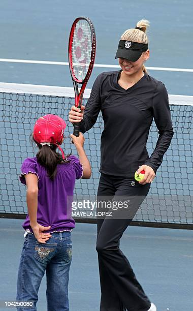 Tennis player Anna Kournikova talks to a young girl September 18 at a hotel in Heredia 18 kilometers north of San Jose during an activity with fans...