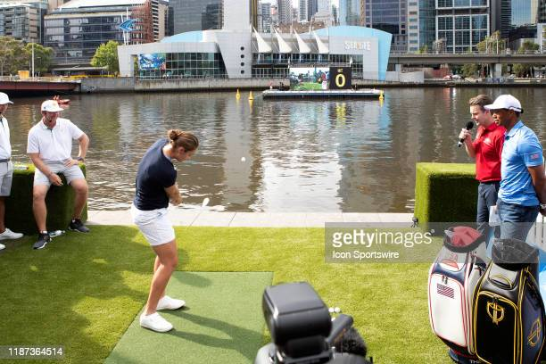 Tennis player Ash Barty of Australia chips towards the green in the middle of the Yarra river during The Presidents Cup official launch at Crown...