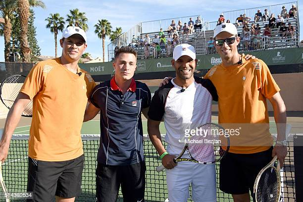 Tennis player Bob Bryan actor Colton Haynes actor Amaury Nolasco and tennis player Mike Bryan pose for portait on court at the 12th Annual Desert...