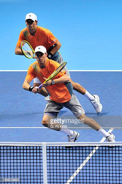 US tennis player Bob Bryan and his partner Mike Bryan run for the ball during their group A doubles match against Spain's Marc Lopez and Spain's...