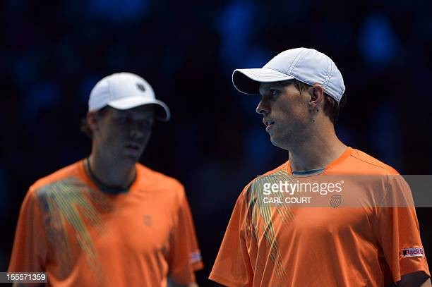 US tennis player Bob Bryan and his partner US player Mike Bryan react during their loss to Spain's Marc Lopez and Spain's Marcel Granollers in their...