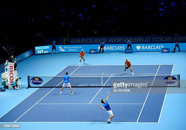 US tennis player Bob Bryan and his US partner Mike Bryan play against Spain's Marc Lopez and Spain's Marcel Granollers during their group A doubles...