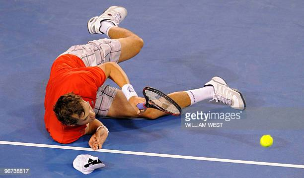 US tennis player Bob Bryan falls on the court during his men's doubles final match with partner Mike Bryan against Daniel Nestor of Canada and Nenad...