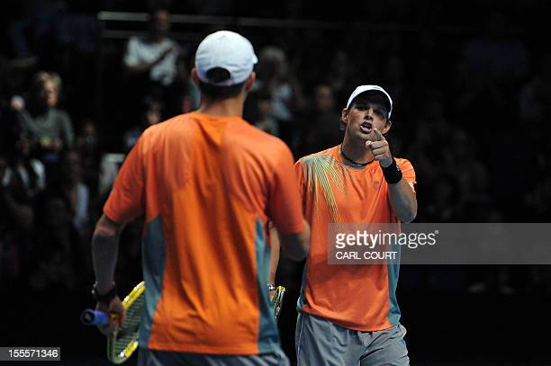 US tennis player Bob Bryan gestures to his partner US player Mike Bryan during their loss to Spain's Marc Lopez and Spain's Marcel Granollers in...