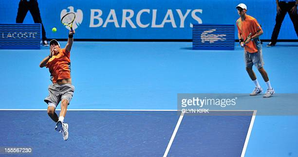 US tennis player Bob Bryan hits a return as his partner Mike Bryan watches against Spain's Marc Lopez and Spain's Marcel Granollers during their...