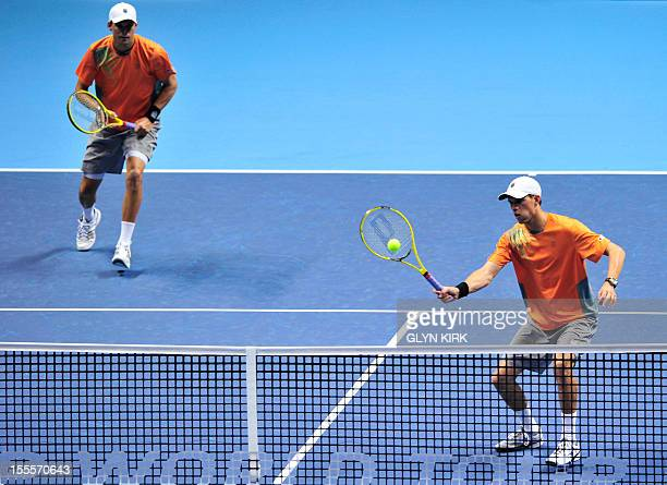 US tennis player Bob Bryan watches as his partner Mike Bryan returns during their group A doubles match against Spain's Marc Lopez and Spain's Marcel...