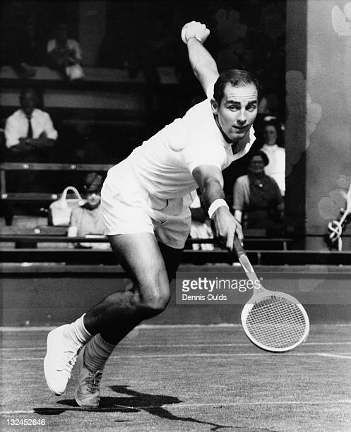 Tennis player Bob Hewitt competing against fellow Australian Martin Mulligan in the quarterfinals of the Men's Singles at Wimbledon, London, 2nd July...