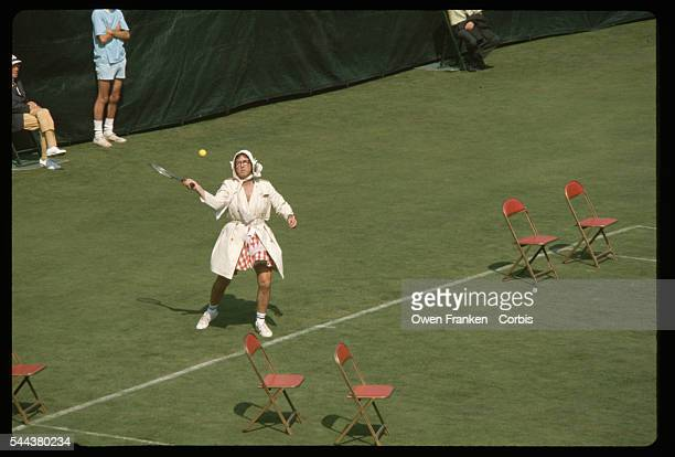 Tennis player Bobby Riggs dresses a woman for his match against Billie Jean King Male chauvinist Riggs challenged King to the match as a battle of...