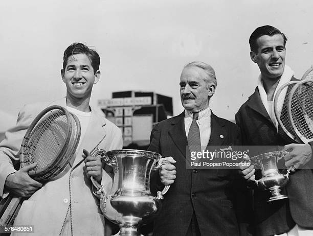 Tennis player Bobby Riggs is presented with the victors trophy by Holcombe Ward President of the US Lawn Tennis Association after defeating Frank...