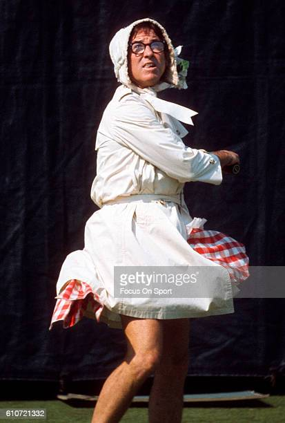Tennis player Bobby Riggs practice in a bonnet and dress prior to playing in a tennis match called Battle of the Sexes II against women's player...