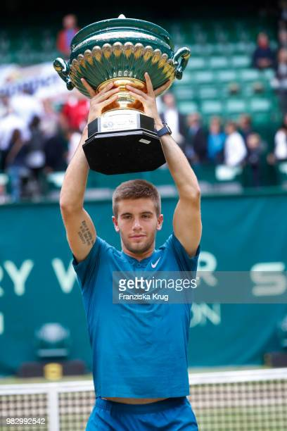 Tennis player Borna Coric of Croatia holds the trophy during the Gerry Weber Open 2018 at Gerry Weber Stadium on June 24 2018 in Halle Germany