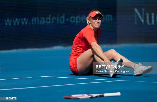 Tennis player Caroline Wozniacki of Denmark falls down during her match against Ksenia Pervak of Kazakhstan during the second day of the WTA Mutua...