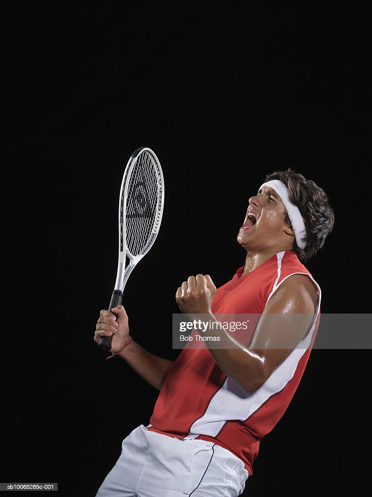 Tennis player celebrating, side view : Foto stock