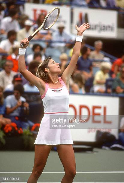 Tennis player Chris Evert of the United States serves during the women 1980 US Open Tennis Tournament at the National Tennis Center in the Queens...