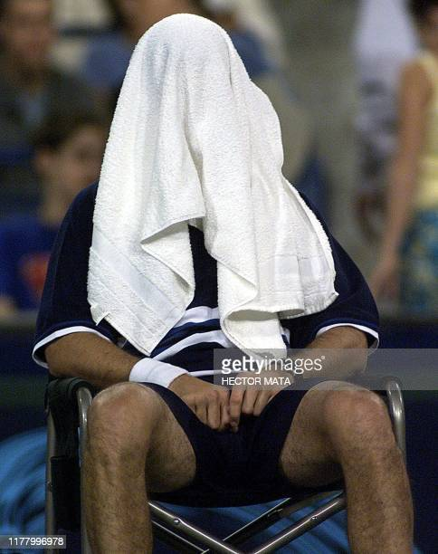 Tennis player Chris Woodruff from the US sits with his towel over his face at the end of the first set against Mark Philippoussis from Australia...