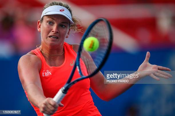 Tennis player Coco Vandeweghe returns the ball to British player Heather Watson during their WTA Mexico Open women's singles tennis match in...