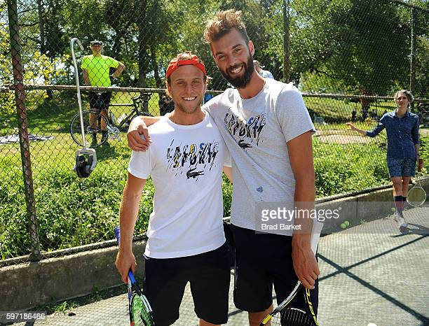 Tennis Player Denis Kudla and Benoit Paire attend LACOSTE And City Parks Foundation Host Tennis Clinic In Central Park at Central Park Tennis Center...