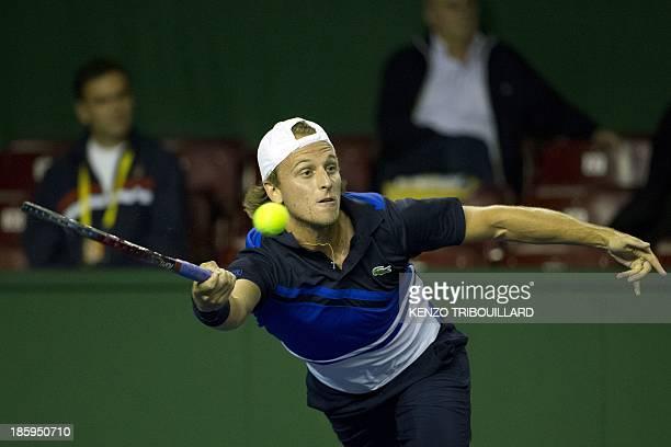 US tennis player Denis Kudla returns the ball to Polish tennis player Lukasz Kubot during their match at the ninth and final ATP World Tour Masters...