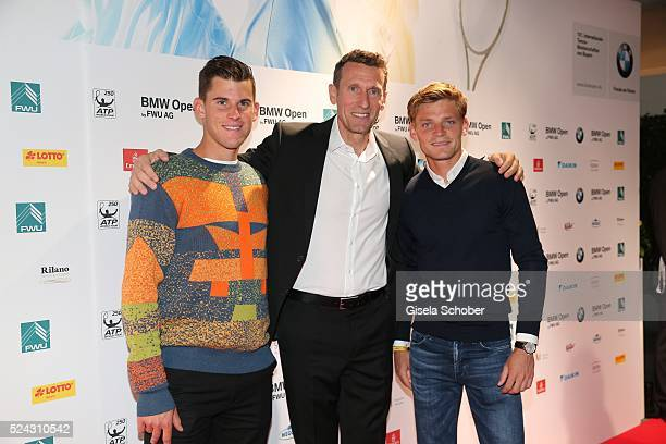 Tennis player Dominic Thiem of Austria Patrik Kuehnen and David Goffin of Belgium during the Players Night of the BMW Open 2016 tennis tournament at...
