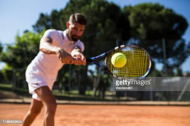 tennis player during a tennis match, focus on tennis ball - tennis player stock pictures, royalty-free photos & images
