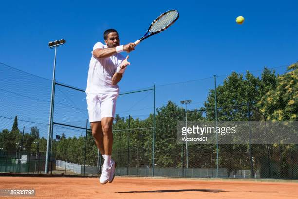 tennis player during a tennis match - colpire foto e immagini stock