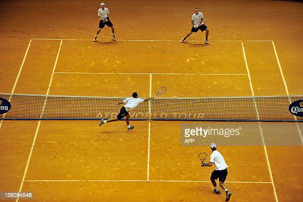 Tennis player Eric Butorac and Brazil's Bruno Soares play against Colombia's Juan Sebastian Cabal and Robert Farah during the Brazil Open 2012...