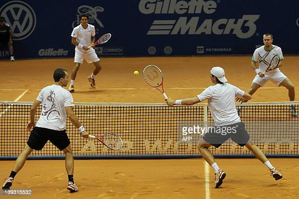 Tennis player Eric Butorac and Brazil's Bruno Soares play against Brazil's Andre Sa and Slovakia's Michal Mertinak during their Brazil Open 2012,...
