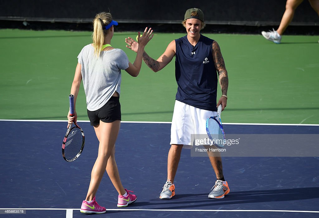 Tennis Player Eugenie 'Genie' Bouchard and singer Justin Bieber attend the 11th Annual Desert Smash Hosted By Will Ferrell Benefiting Cancer For College at La Quinta Resort and Club on March 10, 2015 in La Quinta, California.