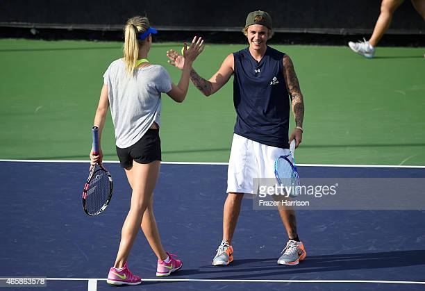 Tennis Player Eugenie 'Genie' Bouchard and singer Justin Bieber attend the 11th Annual Desert Smash Hosted By Will Ferrell Benefiting Cancer For...