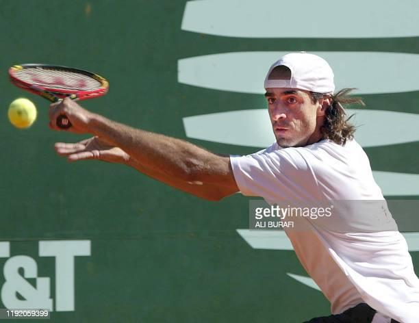 Tennis player Fernando Meligeni is seen in action in Buenos Aires Argentina 20 February 2003 El brasileño Fernando Meligeni le devuelve de revés la...