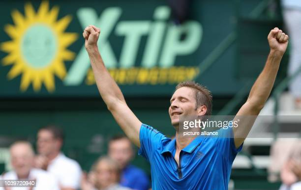 Tennis player Florian Mayer from Germany celebrating his victory over Andreas Seppi from Italy during the ATP Tennis Tournament in Halle Germany 17...