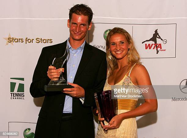 ATP tennis player Florian Mayer of Germany and WTA tennis player Tatiana Golovin of France pose with their Newcomers of the Year awards backstage at...