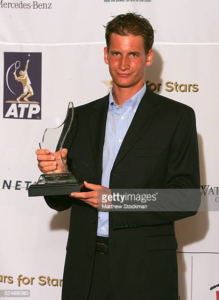 ATP tennis player Florian Mayer of Germany poses with his Newcomer of the Year award backstage at the Stars for Stars A Celebration of Tennis...