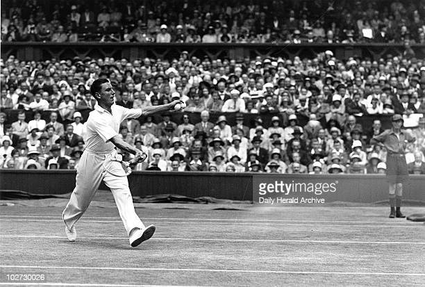 Tennis player Fred Perry in action during Wimbledon 1931. Tennis player Fred Perry in action during the Wimbledon Tennis Championship Tournament, 1...