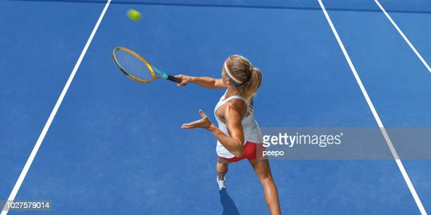 tennis player from above playing tennis on blue hard court - tennis player stock pictures, royalty-free photos & images