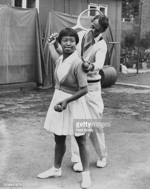 Tennis player Gem Hoahing of then British Hong Kong undertakes some serve coaching in preparation for the Wimbledon Lawn Tennis Championship on 20th...